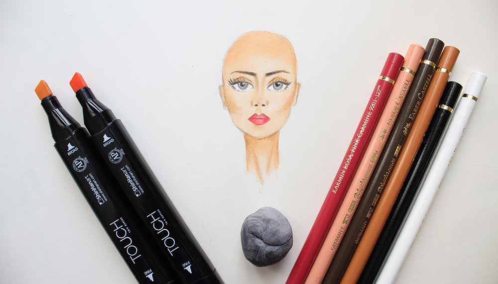 Coloring face with markers and colored pencil